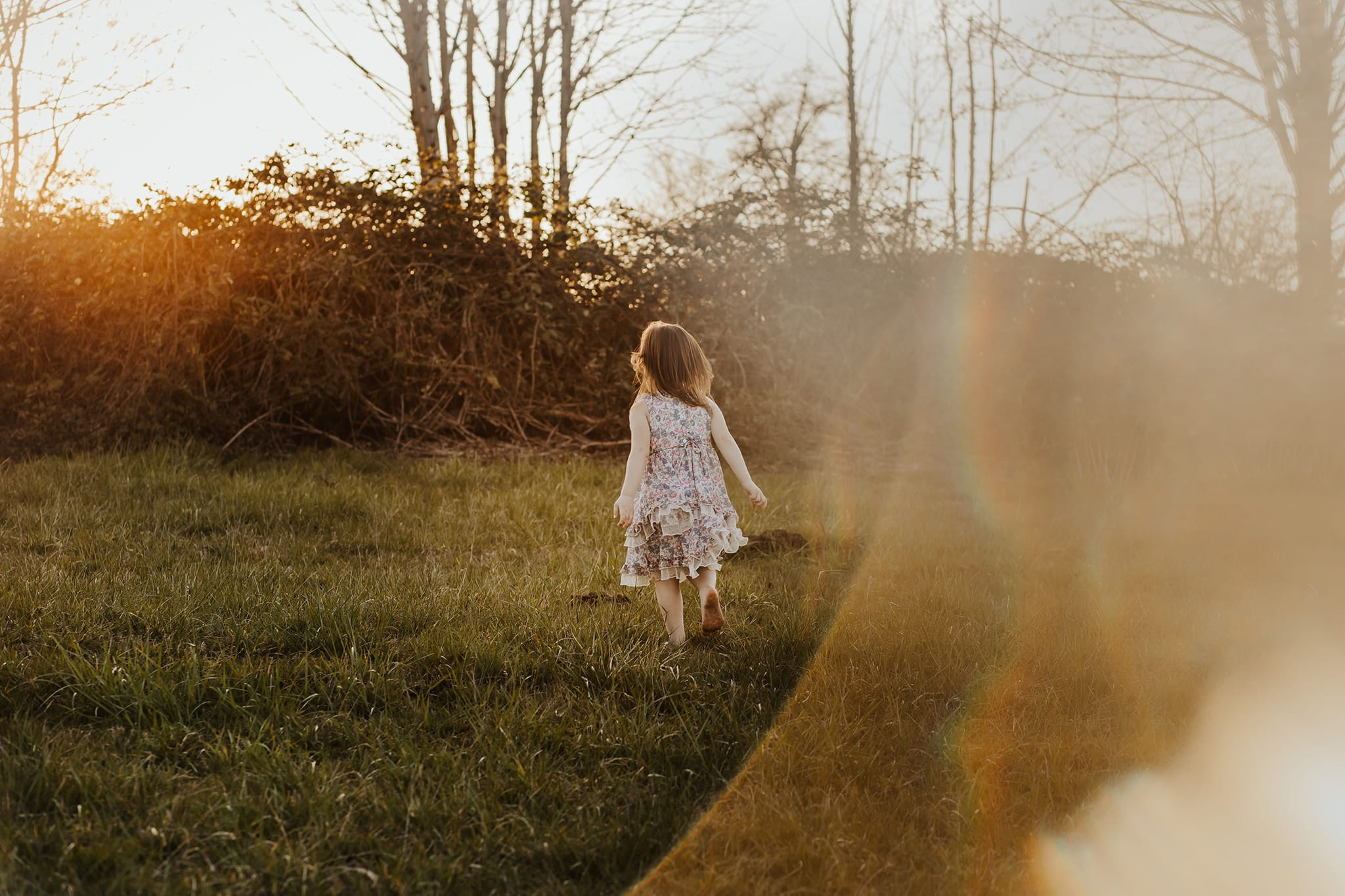 little girl in floral dress running from camera - circular prism tutorial