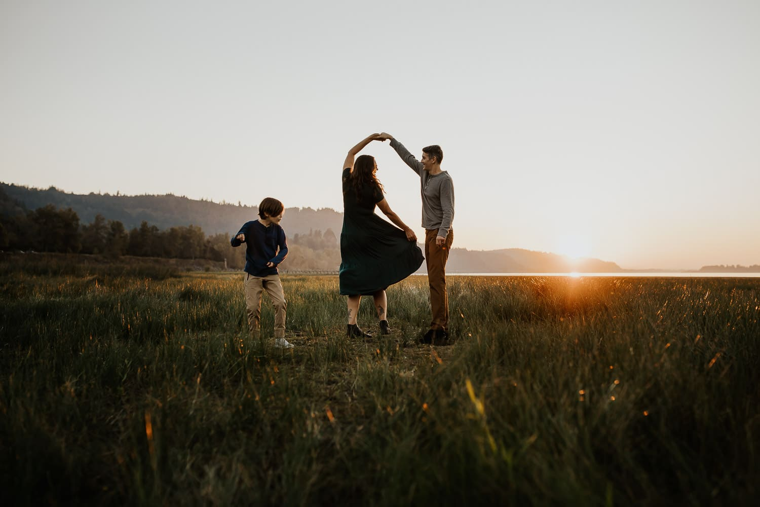 Couple dancing with sun peeking over mountains - Best locations for couples photography sessions