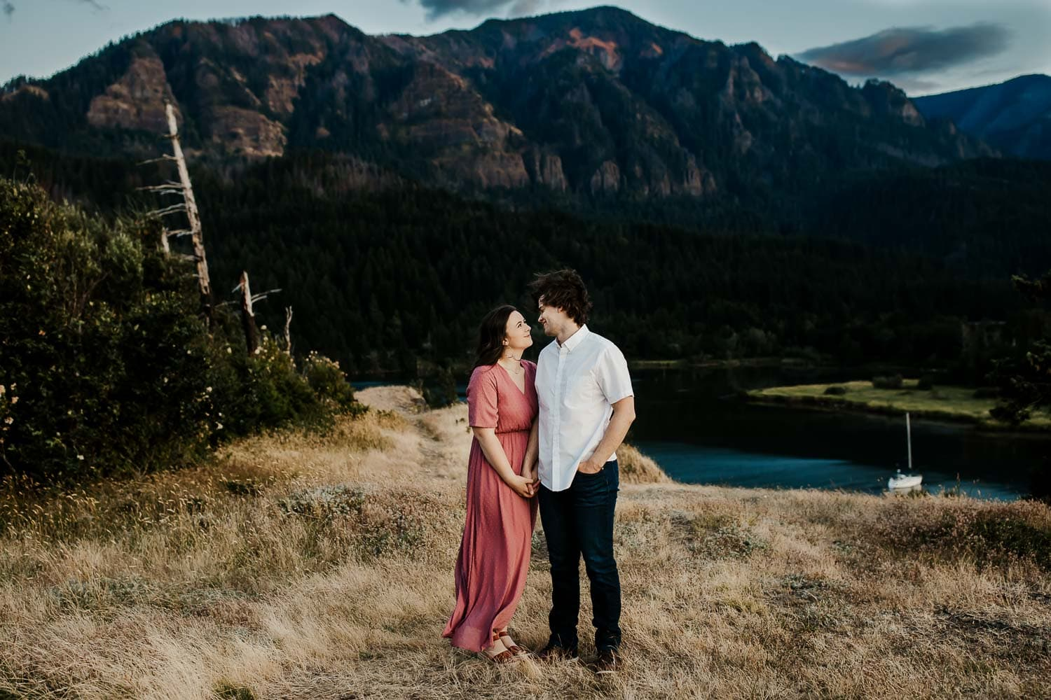 couple holding hands with a mountain in the background - best couples locations