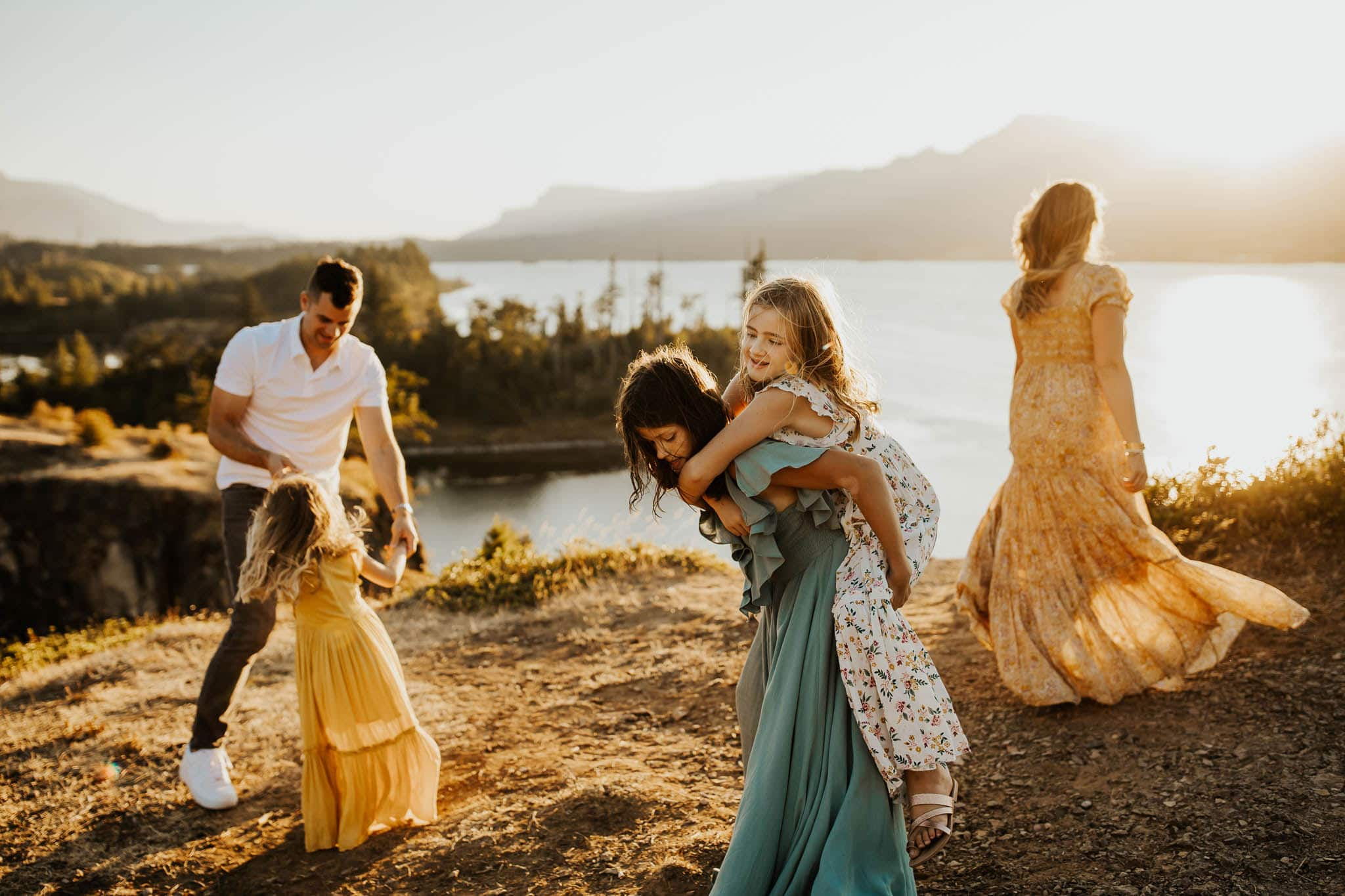family dancing and playing near cliff - what colors to wear for family photo shoot