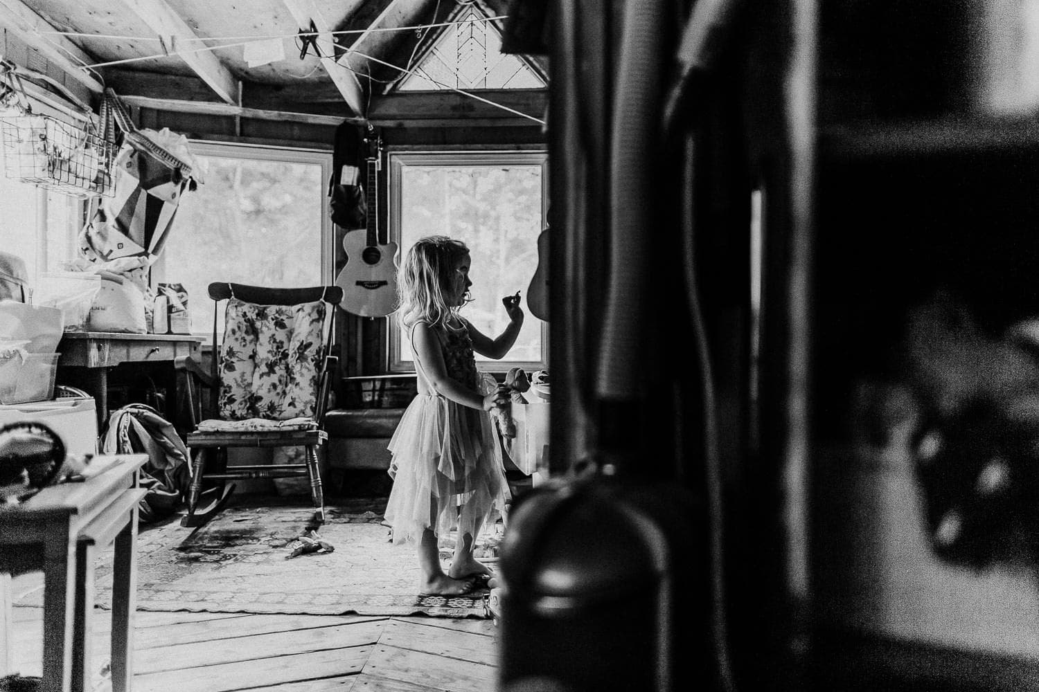 Little girl in room with lots of windows in a dress - what to do at home with kids