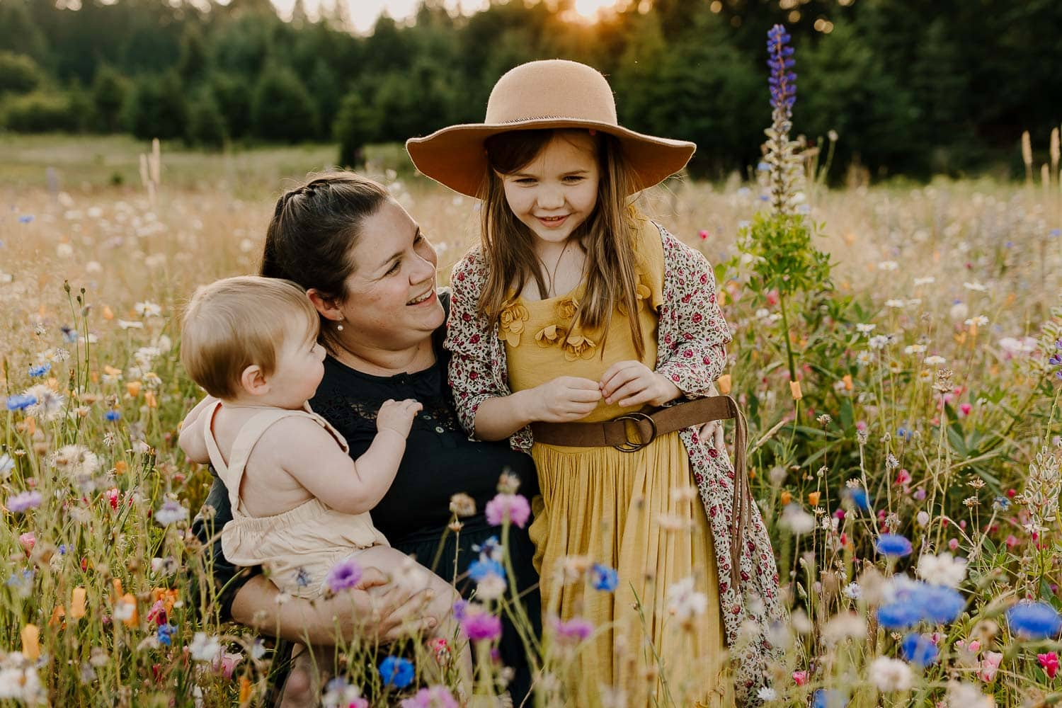 family photo of a mom with her two kids in a field of flowers near Portland