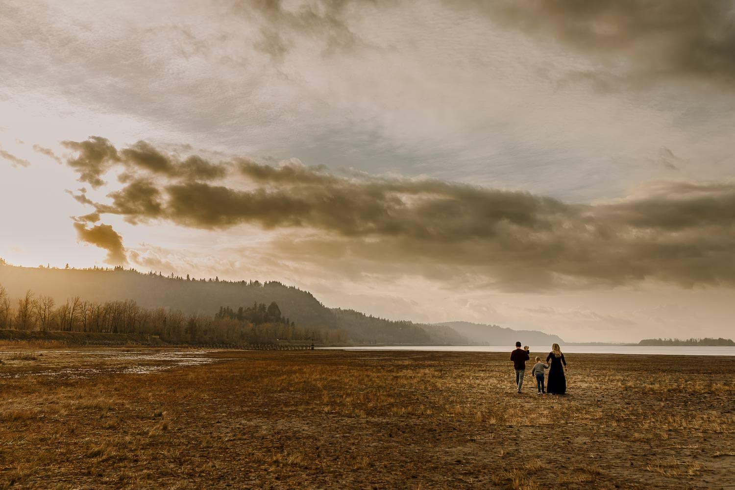Family walking together with mountains in the columbia river gorge