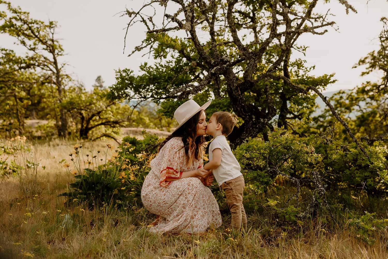 Mom kissing her toddler son
