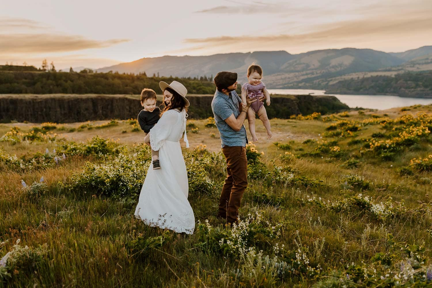 Family of four playing with the gorge in the background at rowena crest