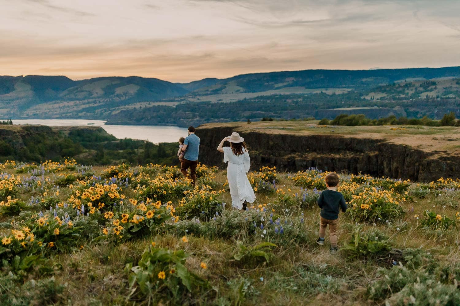 Family walking towards cliff in the columbia river gorge during family photos