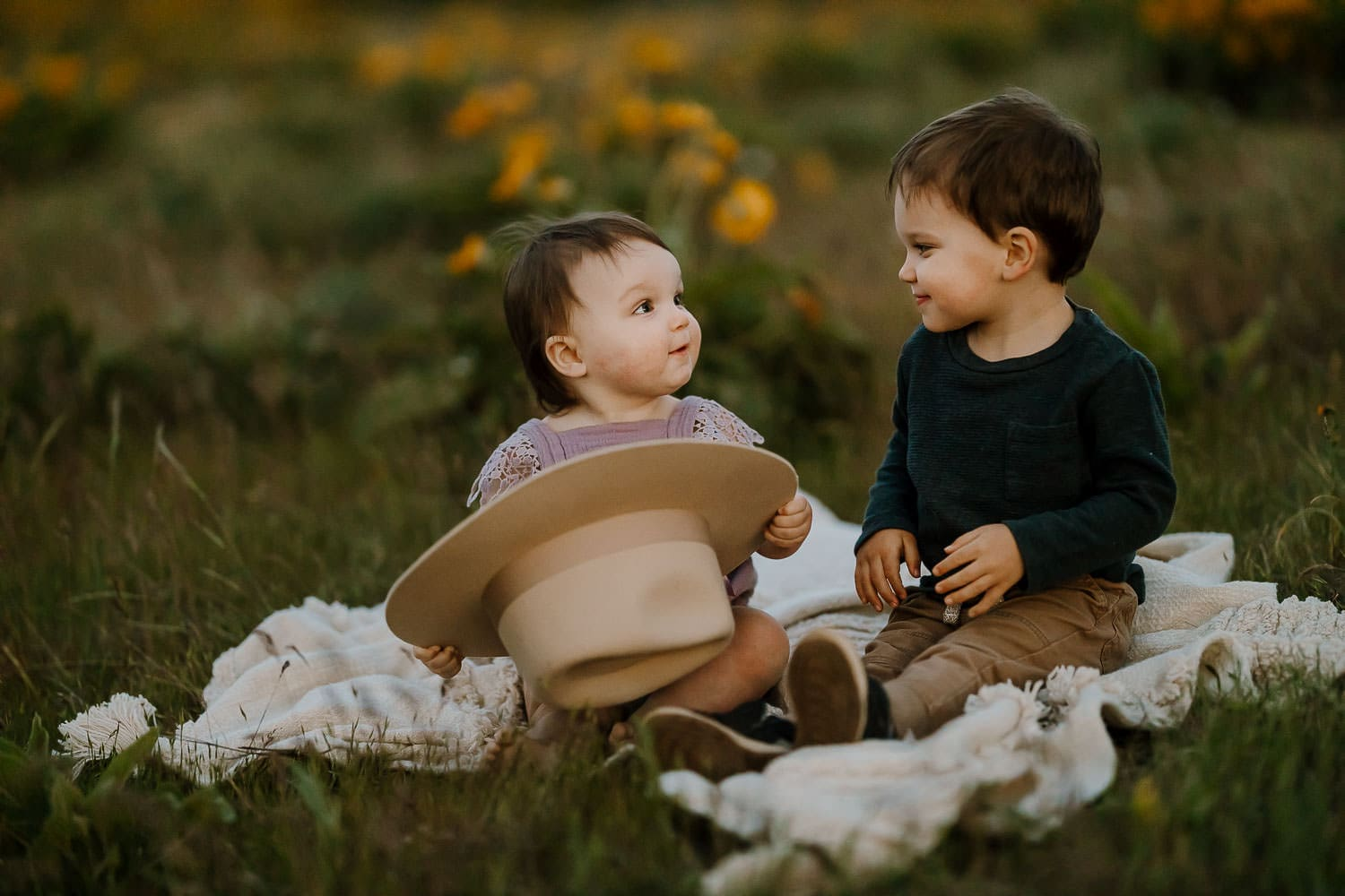 siblings smiling at each other