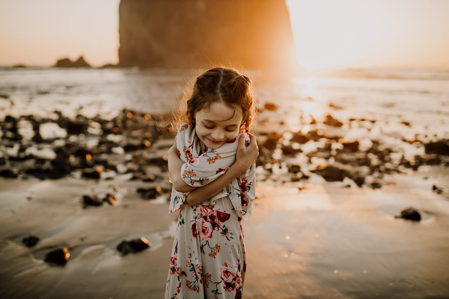 little girl hugging herself at the oregon coast - family photographer