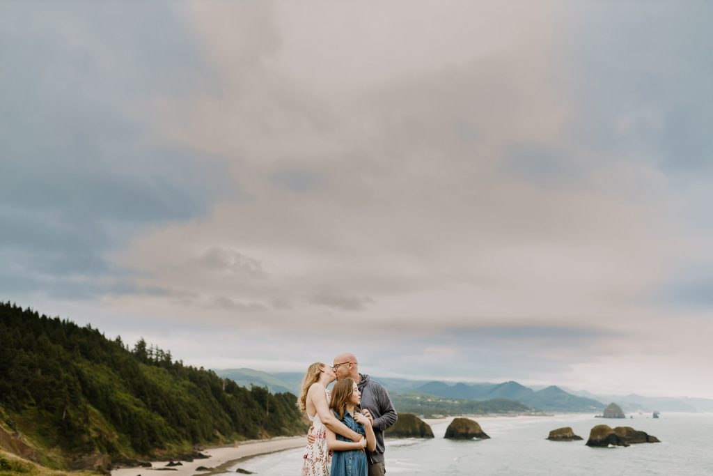 Family hugging while at Ecola State Park near Seaside oregon