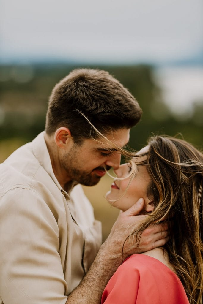 Couple almost kissing with hair blowing in wind