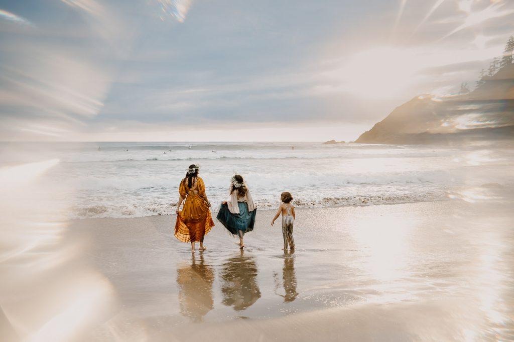 Family splashing in the ocean waves near cannon beach
