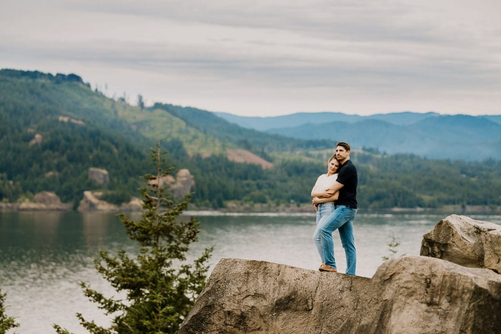 couple on rock, edited with lightroom presets for cloudy days
