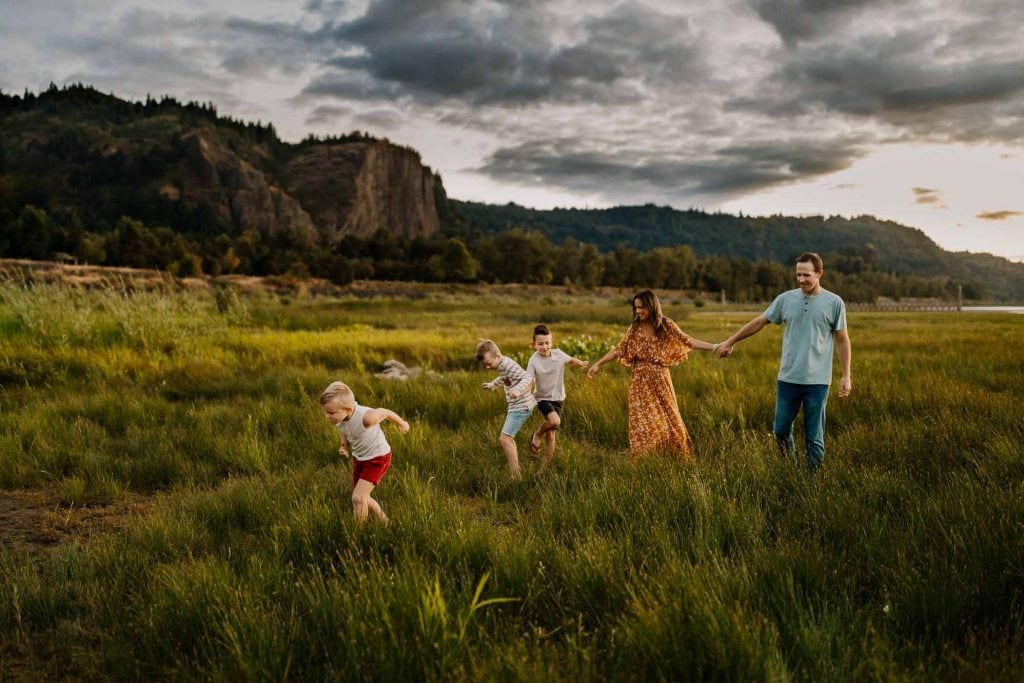 Family of five walking together in a park in portland